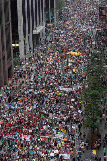 Tens of thousands march down 6th Avenue while taking part in the People's Climate March through Midtown, New York