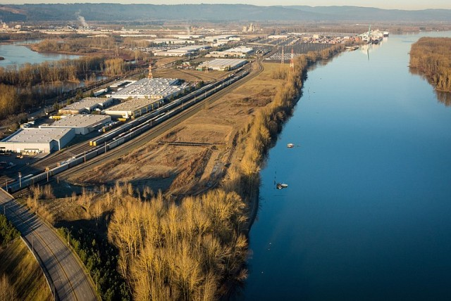 At one point, the Port of Portland considered a vacant swath of land (pictured above between the rail tracks and water) near its Terminal 6 as a potential site for an oil-by-rail terminal. Instead, the undeveloped tract is now under consideration for a propane export terminal. (Bruce Forester/Port of Portland)
