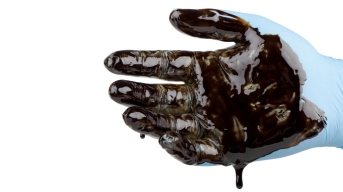 hand-covered-with-oil