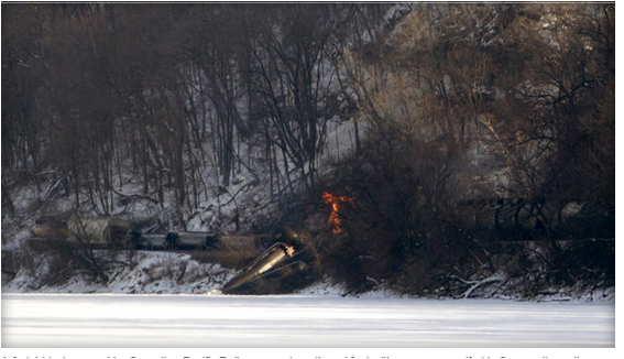 A freight train owned by Canadian Pacific Railway carrying ethanol fuel with one car engulfed in flames sits on the banks of the Mississippi River in a remote location north of Dubuque, Iowa, Feb. 4, 2015, in this picture provided by the Dubuque Telegraph Herald.  MIKE BURLEY/DUBUQUE TELEGRAPH HERALD/HANDOUT VIA REUTERS