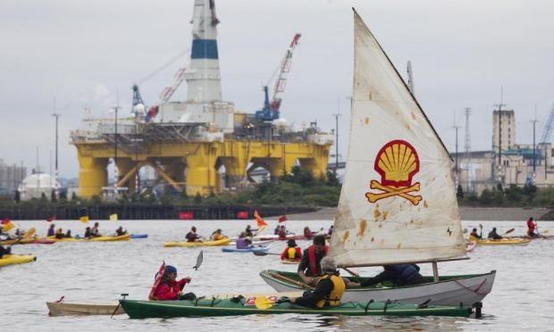 'Shell No' protesters take to the water on Saturday heading near Royal Dutch Shell's Polar Pioneer drilling rig near Seattle. Photograph: David Ryder/Getty Images